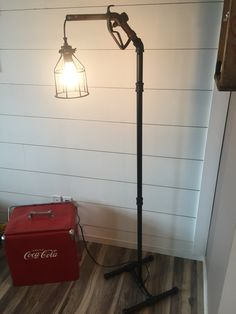 Pipe lamp with vintage gas nozzle. This light is turned on and off by squeezing the gas nozzle lever. The pipe I painted flat black. Fun project.