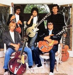 The Traveling Wilburys: Roy Orbison, George Harrison, Bob Dylan, Tom Petty, and Jeff Lynne.   *absolutely loved them*