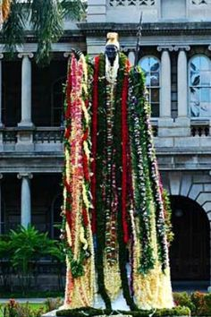 Draped in leis; Statue of King Kamehameha I in Honolulu, Hawaii.