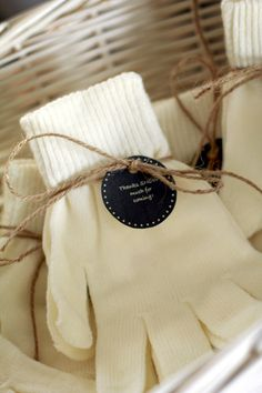 "Gloves as favors to stay with the ""Baby it's cold outside"" theme. With labels that read ""Thanks SNOW much for coming!"""