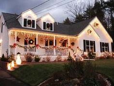 Stunning Outdoor Christmas Displays An Abundance of Wreaths—Each window on this Massachusetts home is covered by simple green wreaths for a classic Christmas look. Exterior Christmas Lights, Outside Christmas Decorations, Christmas Lights Outside, Hanging Christmas Lights, Christmas House Lights, Xmas Lights, Decorating With Christmas Lights, Holiday Lights, Christmas Home