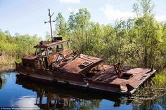 Photographer Thomas Windisch captured these images while visiting Chernobyl dockyard which was once used to supply and repair the nuclear facility before the disaster there in 1986. The rusting wrecks have since been left to decay into the Pripyat river which carried them to the site in the first place