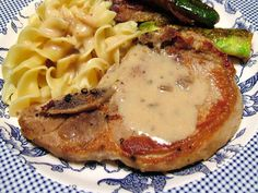 SPOON tender pork chops in a rich and creamy mushroom gravy. Quickly done in the pressure cooker! Great for summer when you dont want to heat up the house!