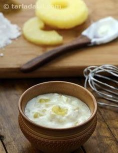 Tangy and sweet pineapples combine very artistically with whisked curds and spice powders to make a tongue-tickling raita that is a perfect accompaniment for parathas. Use canned pineapple to avoid the risk of tartness in the fresh fruit. Also, make sure you use fresh curds and not sour curds to make this fruity treat. Keep the Pineapple Raita chilled till you serve to preserve the freshness.