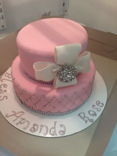 Pink cake with white bow
