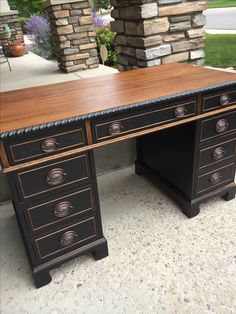 Two-tone wood and black vintage desk. Solid wood and USA made. Located in the Eclectic Grey booth in Ft Collins CO at Vines Vintage Market.