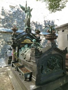 The amazing family grave of the French inventor Charles Pigeon, located in Montparnasse Cemetery in Paris, showing a life-sized bronze sculpture of Pigeon lying in bed next to his dying (or already dead) wife.