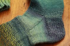 Dear Kay, This is it: the sum total of my personal tips for tidier socks. I'm top-down, two-circs devotee, so if you're a toe-upper, just ignore all this and go watch Maria Bamford's new Netflix series, Lady Dynamite. Tip #1: At the Cuff Cast on an extra stitch. Pattern calls for 64 stitches? Cast on 65. When you join the stitches to begin knitting in the round, pass the last stitch you cast on over the first stitch. It evens out the edge. Tip #2: At the Gusset There's usually a moment when ...