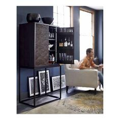 Tessen Bar Cabinet in Bar Cabinets . Grey Blue walls, light chairs, dark furniture