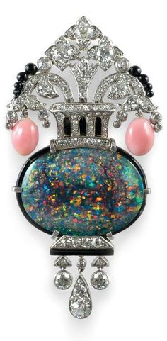 An Art Deco opal, conch pearl and diamond brooch, 1920-40.  The impressive diamond set geometric frame centrally set with a fine oval opal displaying intense play of colour surmounted by two conch pearl drops and fine black enamel and onyx detail, all in platinum. #ArtDeco #brooch:
