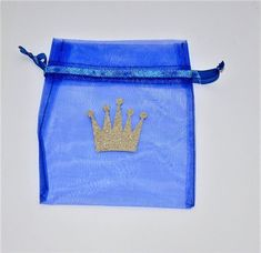 This listing is for a set of 12 royal prince favor bags. Each bag is made of a royal blue drawstring organza material and is adorned with a gold glitter prince crown. The measurements of the bag are the following- Height= 6inches; Width= 4 inches. The bag is big enough to fit a
