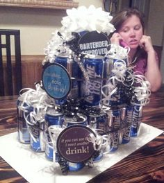 """Beer cake for my friend's dad! One of my dear friends made one of these for me... BEST birthday present ever. Personalize with cigars, beef jerky. 24 ouncer for the 3rd """"tier"""""""