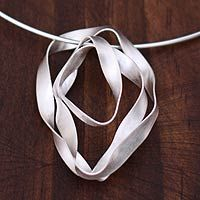 """Sterling-silver """"Ribbon Tribute"""" choker by Carlos and Cynthia Rendon. (Yes, that's silver formed to look like a ribbon hanging off the choker!)"""