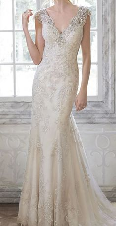 Delicate lace wedding dress with beaded cap sleeves. | The Wedding Shoppe | Celebrating 40 Years in the Wedding Industry