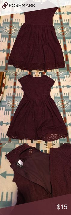 H&M Eyelet Lace Dress This is the loveliest shade of deep burgundy that begs your attention this season. Perfect for any holiday get together or coffee shop day. (Warning: H&M sizes run a bit on the smaller size. This fits like a 10 or L.) H&M Dresses