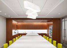 Located on the 36th floor, the Angelo Gordon's Twin Brooks Capital Partners collaboration-focused office has some of the best views of Chicago! The views are accentuated by Architect Stephen Yablon's use of glass partitions, award-winning lighting, and walnut SoundPly Latus Acoustic Wall Panels. #OfficeDesign #SoundPly #Chicago Wood Ceiling Panels, Wood Ceilings, Acoustic Wall Panels, Glass Partition, Design System, Modular Design, Custom Lighting, Showcase Design, Architecture Design