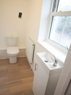 It might be the smallest room but our downstairs loo is one of my favourite rooms in the house. Here is my Downstairs Bathroom Dark grey Makeover with before and after photos and I'm so pleased with how this turned out. Small Basement Bathroom, Downstairs Toilet, Bathroom Plans, Bathroom Plumbing, Small Bathroom Storage, Bathroom Ideas, Bath Ideas, Sainsburys Home, Gold Bathroom Accessories