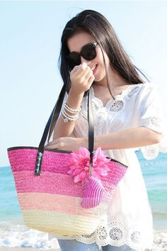 Women's PINK shades straw summer beach tote handbag with flower decoration and attached straw coin purse.