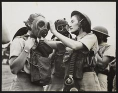 This picture is from World War II and shows a woman from South Africa helping a soldier put on a gas mask. The picture was taken somewhere in the Middle East. I don't know much about what role South Africa had in World War II. Old Pictures, Old Photos, Canvas Art, Canvas Prints, Portraits, Science Photos, Second World, Female Portrait, African Women