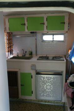 Boler kitchen with faux tiled backsplash, etched-effect fridge door.