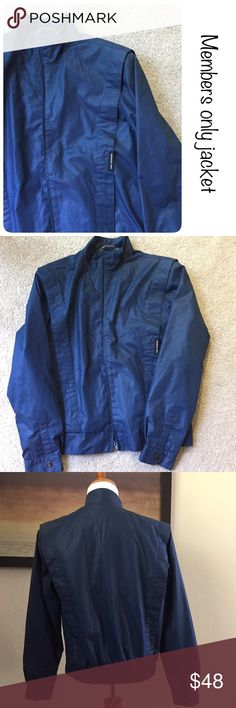 Vintage blue members only jacket size medium ♦️Excellent condition, no holes, piling or stains.  ♦️Made of 65% polyester/35 Cotton ♦️Measurements: ♦️Underarm to underarm flat across is approximately 16 inches ♦️Back of neck to bottom of hem is approximately 19 inches Members Only Jackets & Coats
