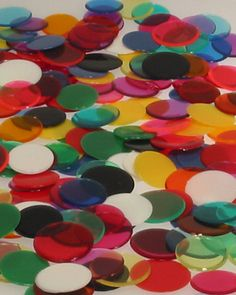 I remember having a million of these little plastic pieces, but I don't actually remember the game.   Tiddly Winks.