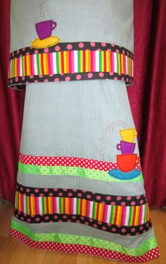 Jungle green pin stripe rida designed using vibrant colored panels and tape laces making it unique with it's colorful hand made applique felt tea-cups on the sides and back. Perfect for today's youth !