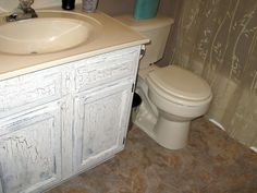 I think I will try doing something like this with my bathroom vanity - a lot cheaper than trying to replace it!
