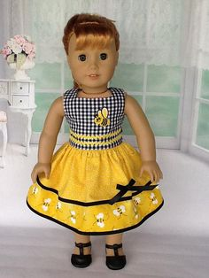 18 inch doll dress. Fits American Girl Dolls. Honeybee print with gingham contrast.