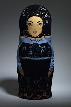 Top designers dress Russian dolls for Russian Vogue's 10th Anniversary. Designed by Prada.