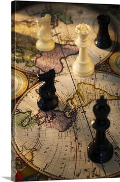 Chess pieces on old world map- do it on small ledge/shelf showing where we've traveled
