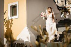 A Santorini Wedding at Sunset by Vangelis Photography | Fly Away Bride - Floral design by Fabio Zardi (www.fabiozardi.com)