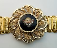 An Antique Early Victorian Era Gold, Diamond and Enamel Locket Bracelet Russian, circa 1840 The 14K gold hollow link bracelet is centered with a locket med