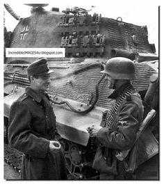 A grenadier from the SS Panzer Division Totsnkopf talking with a Hungarian soldier (left) in Budapest, October The Panzerkampfwagen VI Tiger II Königstiger is from schwere SS-Panzer-Abteilung 503 Heavy Tank Battalion). Tiger Ii, German Soldiers Ww2, German Army, Mg 34, Tank Armor, Germany Ww2, Tiger Tank, Ww2 Photos, Germany
