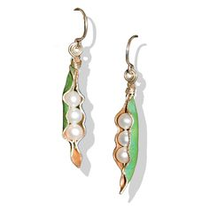 Pearl Pod Earrings are handcrafted from a salvaged historic Frank Lloyd Wright copper roof. A portion of proceeds go to help house the homeless. $46. Available at Design With Benefits