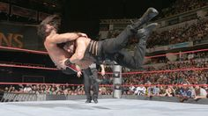 Reigns prepares for victory after hitting a Spear ...