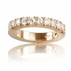 Alliansring i guld med flera diamanter.