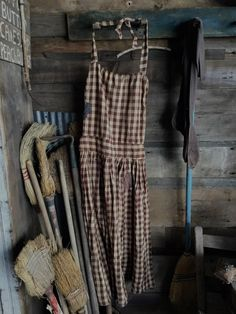 Primitive brown homespun farm apron, primitive blue paint broom. Primitive brooms. Sweet Liberty Homestead