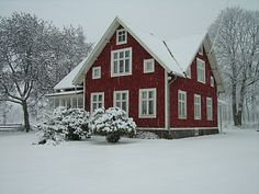 traditional swedish house with red walls and white windows. these