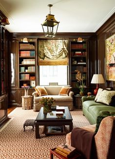 Absolutely stunning, chocolate brown gloss library on Park Avenue by Ashley Whittaker.