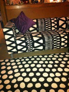 Ikea Klippan love seat, rug, an pillow covers