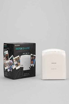 Fujifilm INSTAX Instant Smartphone Printer - Urban Outfitters  This looks so cool! To print pictures for journaling while traveling...