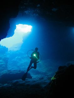 Exploring a limestone cave under the Pacific island of Niue.