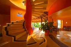 The colorful walls and floating staircase of Dos Estrellas (our villa) capture Careyes' creative spirit.