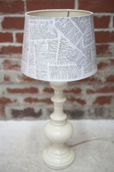 A DIY lampshade using book pages. I just don't know if I could dare hurt a book to do so...
