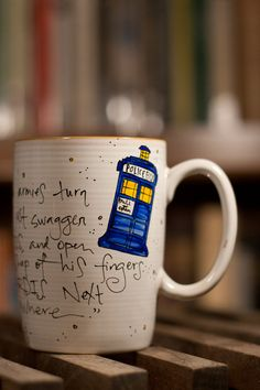 """Doctor Who """"The Doctor. In the TARDIS. Next stop: Everywhere"""" River Song Quote Mug - Large White mug with TARDIS and diary. $16.00, via Etsy."""