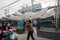 max gerthel + tectonicus' breathing 'octopus pavilion' lights up beijing's baitasi district  www.designboom.com