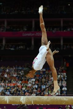 US gymnast Gabby Douglas performs during the women' s beam final of the artistic gymnastics event of the London Olympic Games on August 7, 2012 at the 02 North Greenwich Arena in London.