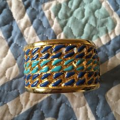 """Enamel bracelet Gold tone hinge bracelet with blue and teal enamel braid detail. Not sure of brand, bought from ShopBop a couple years ago. Excellent construction, no flaws. 8.5"""" circumference. Jewelry Bracelets"""