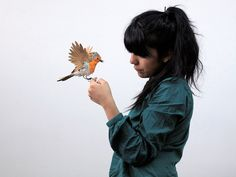 Stunningly Lifelike Birds Made Entirely From Paper | Portrait of the artist and a lil' bird.   | Credit: Diana Beltran Herrera | From WIRED.com